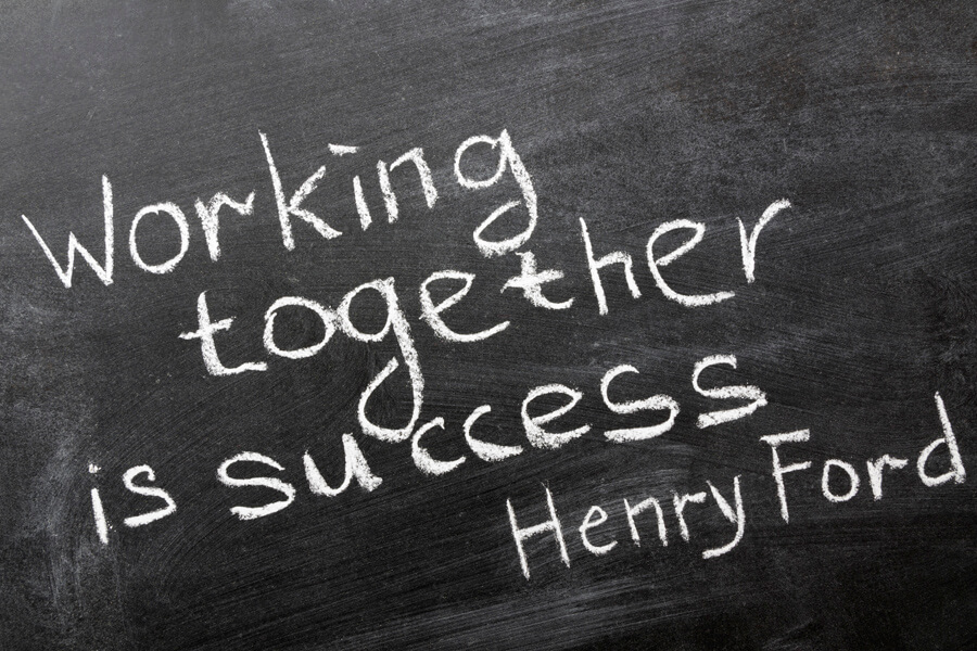 "final phrase of famous Henry Ford quote ""Coming together is a beginning. Keeping together is progress. Working together is success."" handwritten on blackboard"