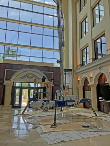 this image shows the 105' MasterReach lift positioned inside the lobby.